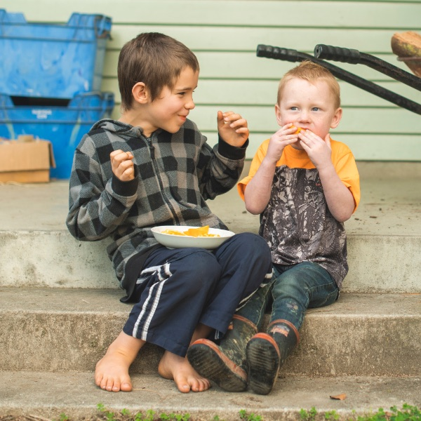 Children eating orange